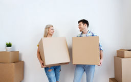 Smiling couple with big boxes moving to new home Royalty Free Stock Image