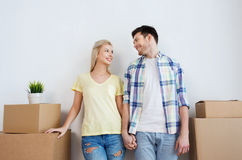 Smiling couple with big boxes moving to new home Royalty Free Stock Photo