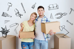 Smiling couple with big boxes moving to new home. Home, people, repair and real estate concept - smiling couple with big cardboard boxes moving to new place over stock photos