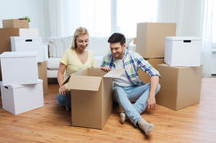 Smiling couple with big boxes moving to new home Stock Photo