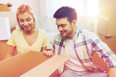 Smiling couple with big boxes moving to new home Stock Photography