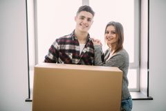 Home, people, repair and real estate concept - smiling couple with big cardboard boxes moving to new place stock photography