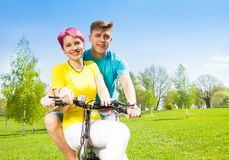 Smiling couple on the bike Stock Images
