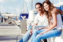 Smiling couple at boat harbour Stock Photography