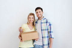 Smiling couple with box moving to new home Stock Image
