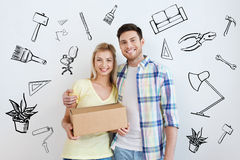 Smiling couple with box moving to new home Stock Photography
