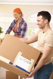 Smiling couple with boxes Royalty Free Stock Image