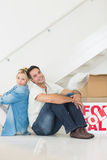Smiling couple with boxes in a new house Stock Photo