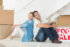 Smiling couple with boxes in a new house Royalty Free Stock Image