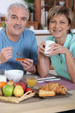 Smiling couple at breakfast Stock Photo