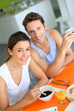 Smiling couple at breakfast table Stock Photos