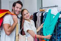 Smiling couple browsing clothes Royalty Free Stock Photography