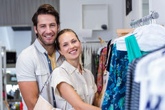 Smiling couple browsing clothes Royalty Free Stock Photos