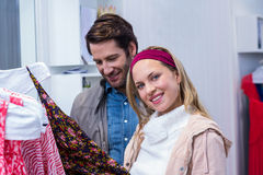 Smiling couple browsing clothes Royalty Free Stock Images