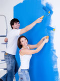 Smiling couple brushing the wall Stock Photography