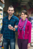 Smiling Couple Buying Dairy Products In Supermarket Royalty Free Stock Photo