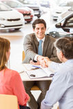 Smiling couple buying a new car Royalty Free Stock Image
