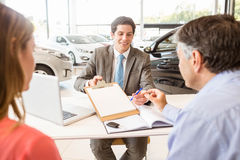 Smiling couple buying a new car Royalty Free Stock Photo