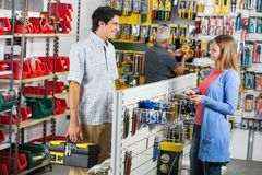 Smiling Couple Buying Tools In Hardware Store Stock Photo