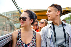 Smiling couple with camera traveling by tour bus. Friendship, travel, vacation, summer and people concept - smiling couple with camera traveling by tour bus Stock Photo