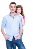 Smiling couple in casual standing in studio. royalty free stock photos