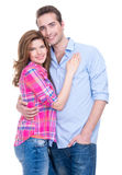 Smiling couple in casual standing in studio. royalty free stock photo