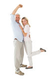 Smiling couple cheering at the camera Royalty Free Stock Image