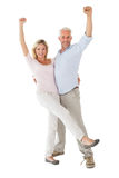 Smiling couple cheering at the camera Stock Images