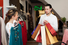 Smiling couple choosing clothes at boutique Royalty Free Stock Photography