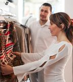 Smiling couple choosing clothes Royalty Free Stock Images