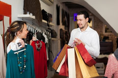 Smiling couple choosing clothes Stock Images