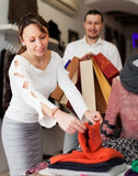 Smiling couple choosing clothes at store Stock Photo
