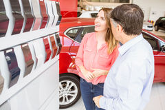 Smiling couple choosing the color of their new car Royalty Free Stock Images