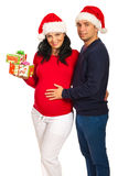 Smiling couple with Christmas gifts Royalty Free Stock Photography