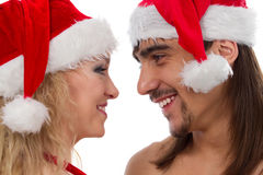 Smiling couple in Christmas hats Stock Image
