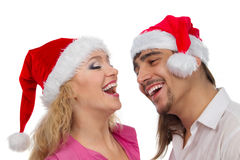 Smiling couple in Christmas hats Stock Photography