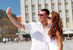 Smiling couple in city Royalty Free Stock Image