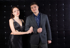 Smiling Couple in Classy Outfits Looking at Camera Royalty Free Stock Photography