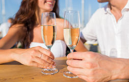 Smiling couple clinking champagne glasses at cafe Stock Photography