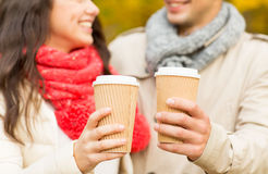 Smiling couple with coffee cups in autumn park Stock Image
