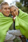 Smiling couple on cold autumn day outdoors Stock Photography