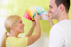 Smiling couple with color samples Stock Images