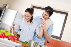 Smiling couple cook in modern kitchen Royalty Free Stock Image