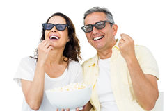 Smiling couple with 3D glasses eating popcorn Royalty Free Stock Photo