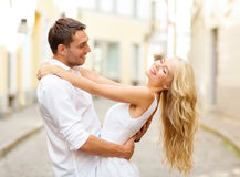 Smiling couple dancing in the city Stock Photography