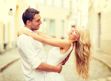 Smiling couple dancing in the city Royalty Free Stock Photos
