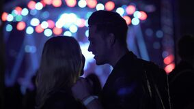 Smiling couple dancing and talking at concert, people enjoying music at club. Stock footage stock video