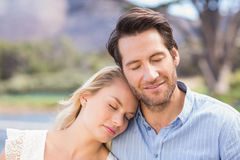 Smiling couple on date relaxing with eye closed Royalty Free Stock Photos