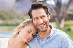 Smiling couple on date relaxing with eye closed Royalty Free Stock Photo