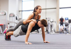 Smiling couple doing push-ups in the gym Stock Image